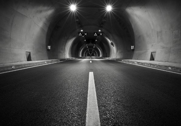 Image of a lighting in a dark tunnel environment.